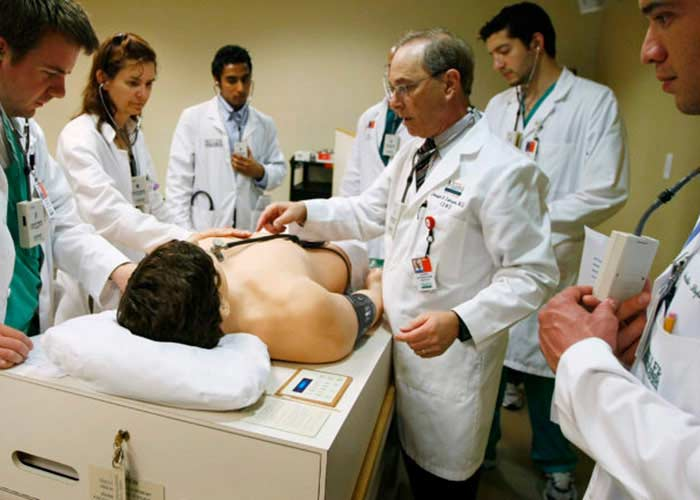 a group of doctors examining a patient